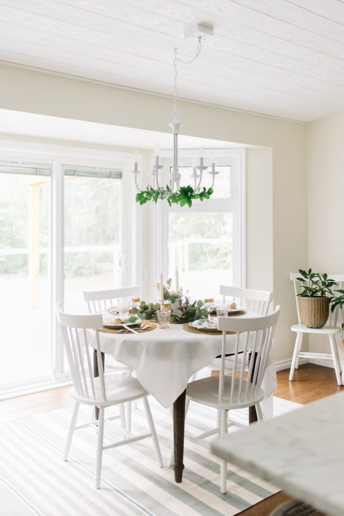 A light bright dining nook wth round table