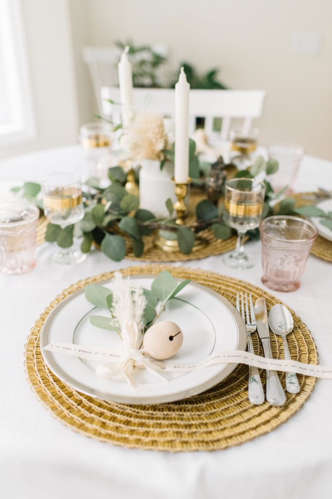 golden thanksgiving table with seagrass place mats and wooden ornaments