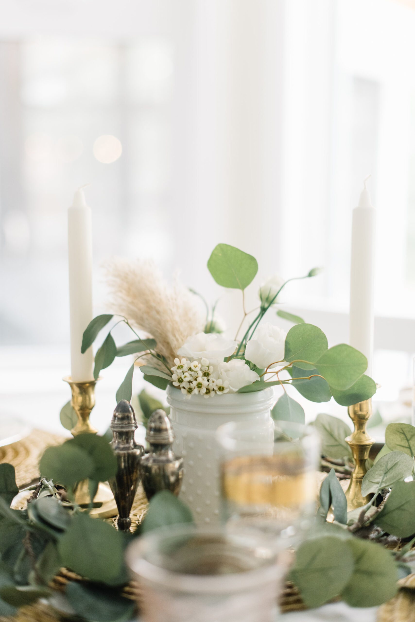 milk glass vase with dried and fresh flowers