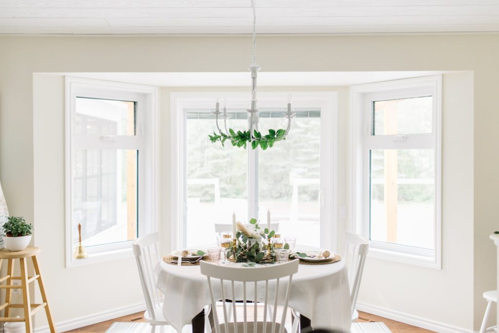 dining room with greens on the chandelier