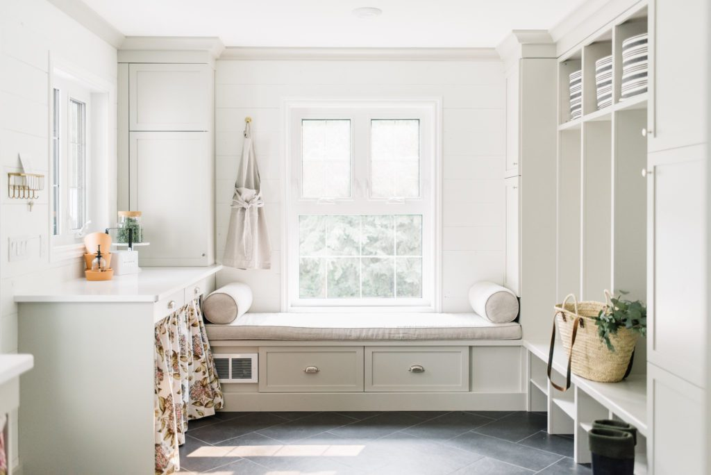 Small space living requires organization.  A well designed mudroom has designated storage areas to handle clutter.