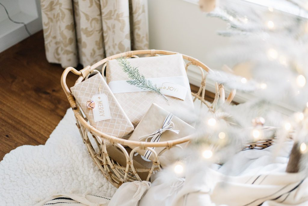 Gifts can double as decor when placed in a pretty basket beside the tree