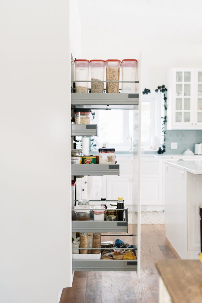 Pull out pantry cupboards add much needed storage in a small kitchen