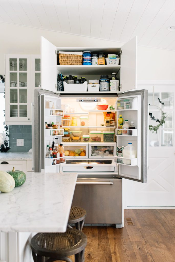 counter depth fridge open and full of food