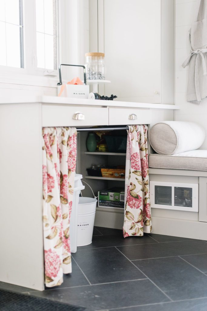 Curtains instead of cupboards in the mudroom hide clutter and allow for storage of larger items