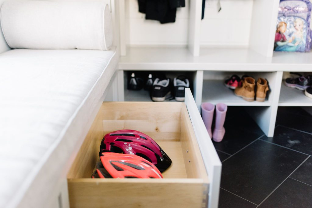 Drawers in the mudroom store bike helmets and add needed storage at The Ginger Home