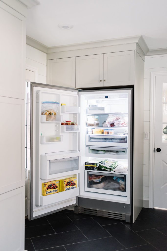 An extra freezer provides overflow storage for the kitchen