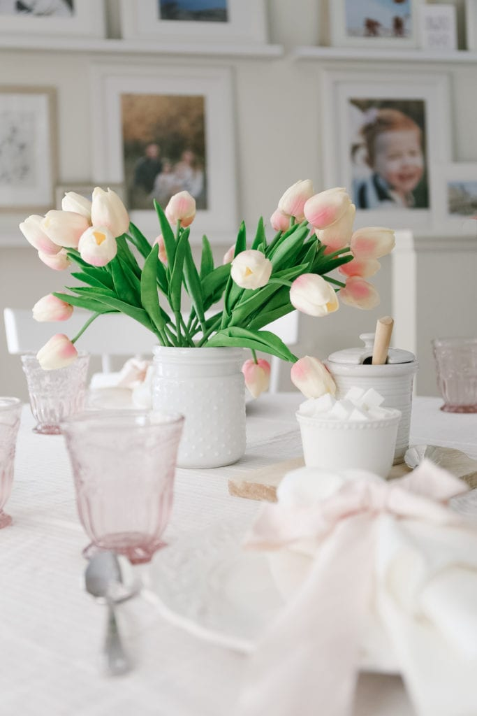 A vase of tulips on a table