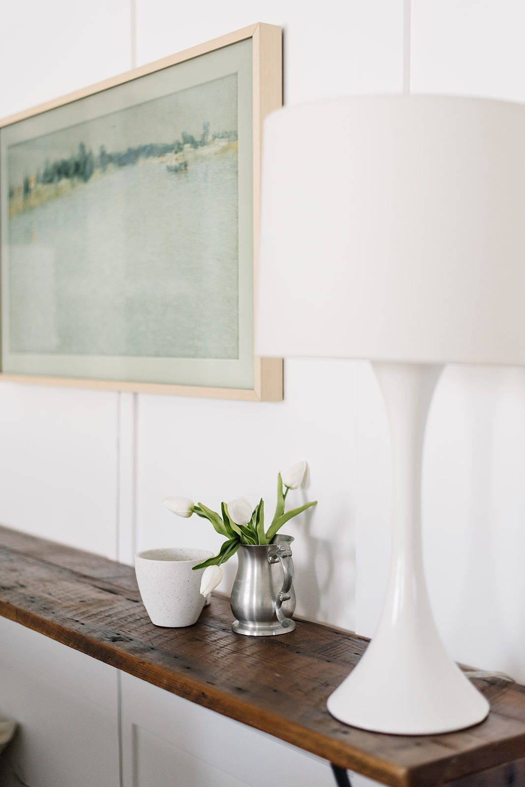white lamp on a wooden console table