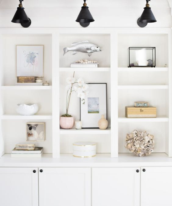 Lighting adds ambience and function to bookshelf styling