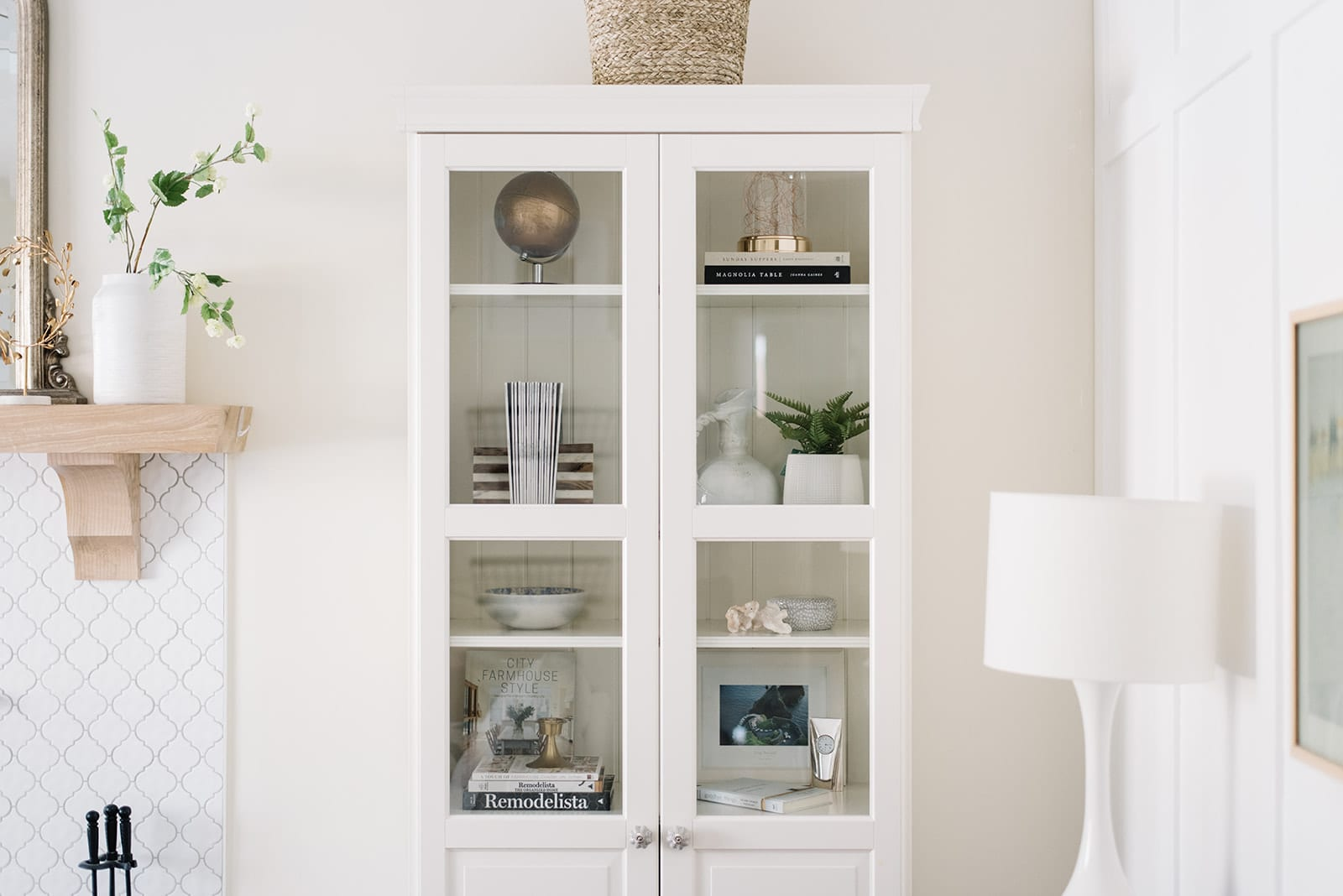 How to style a bookcase - keep it simple and follow the guiding principles of space, unity, and balance.