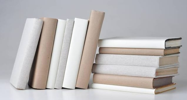 Jacket covers on books allow for a uniform appearance on a bookshelf