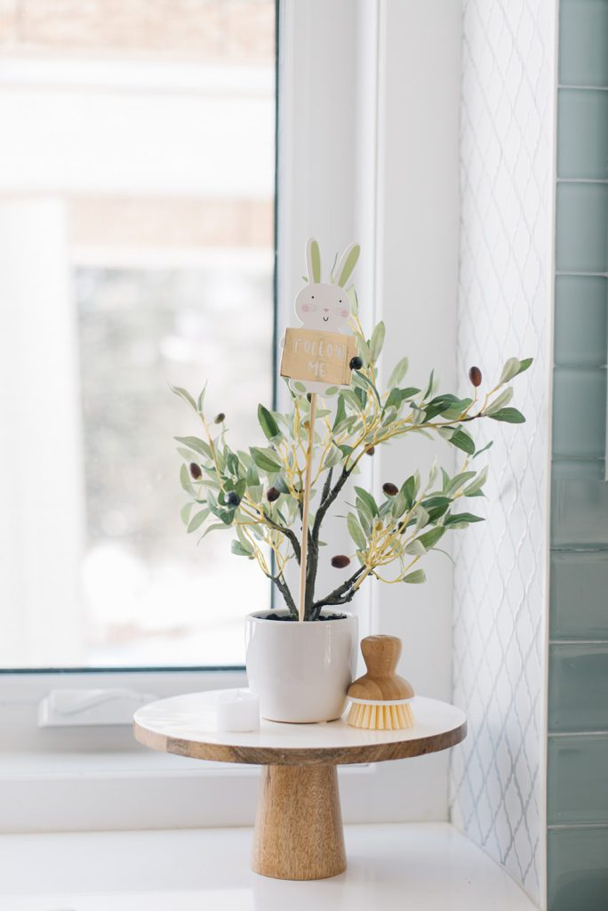 A plant with an Easter Egg hunt sign on a pedestal