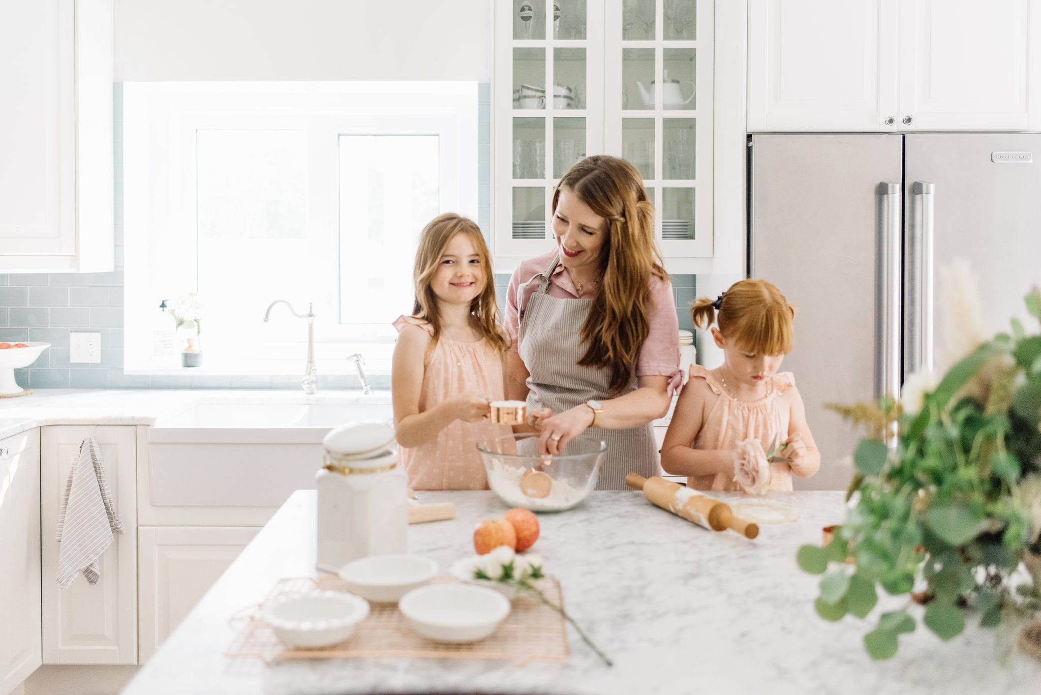 Woman and children baking in the kitchen