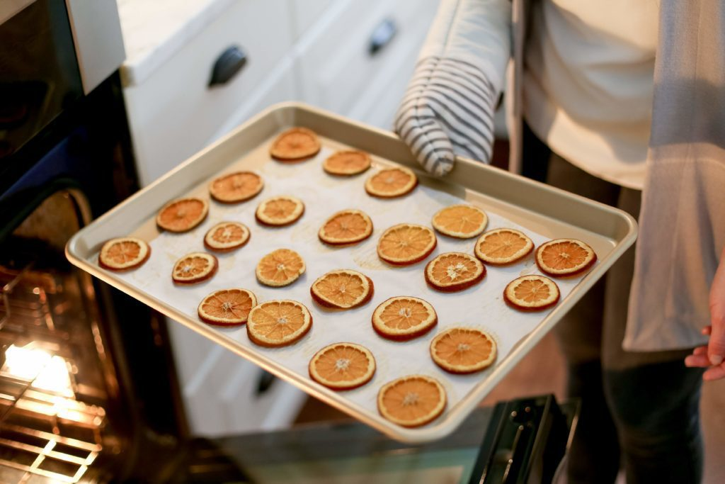 Dried orange slices coming out of the oven