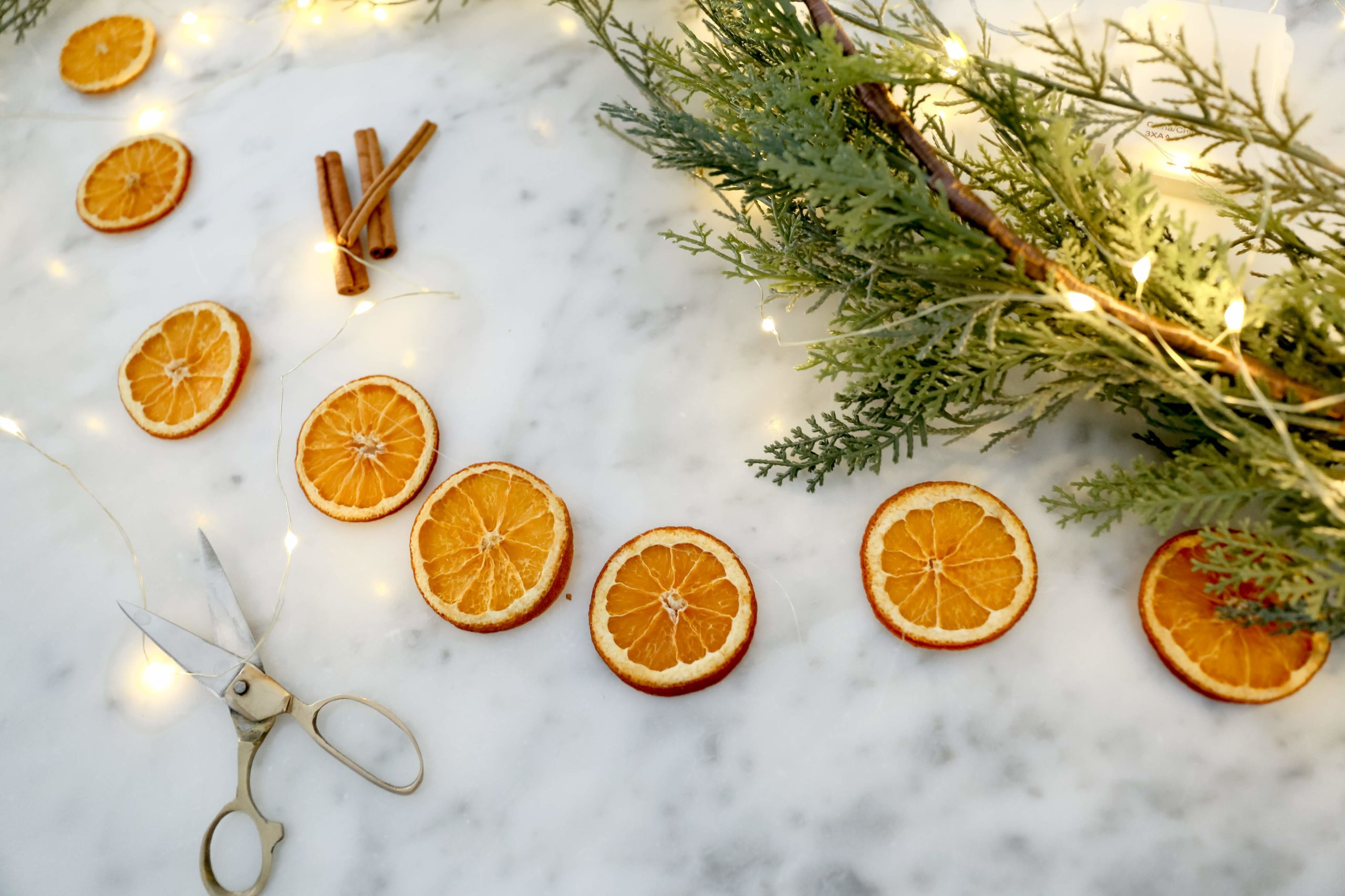 dried orange garland on a marble countertop