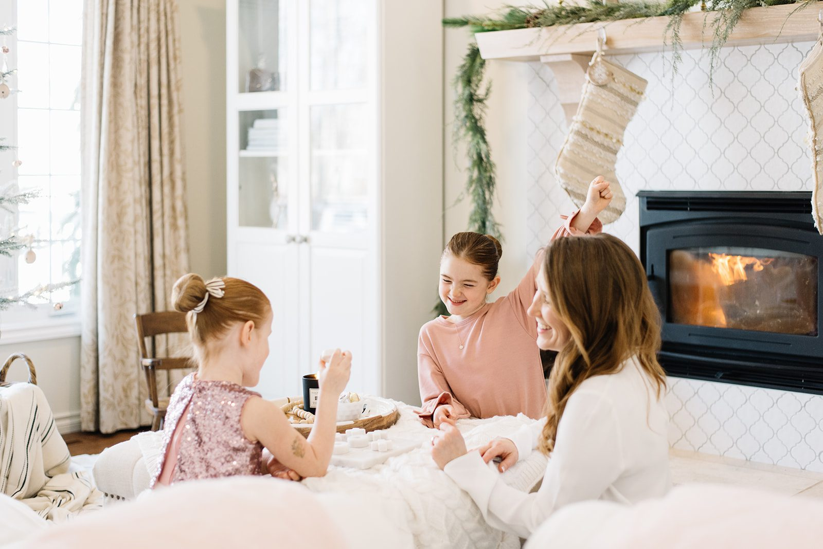 Mom and daughters playing a game