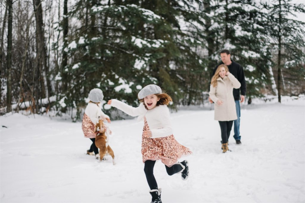 Family plays in the snow
