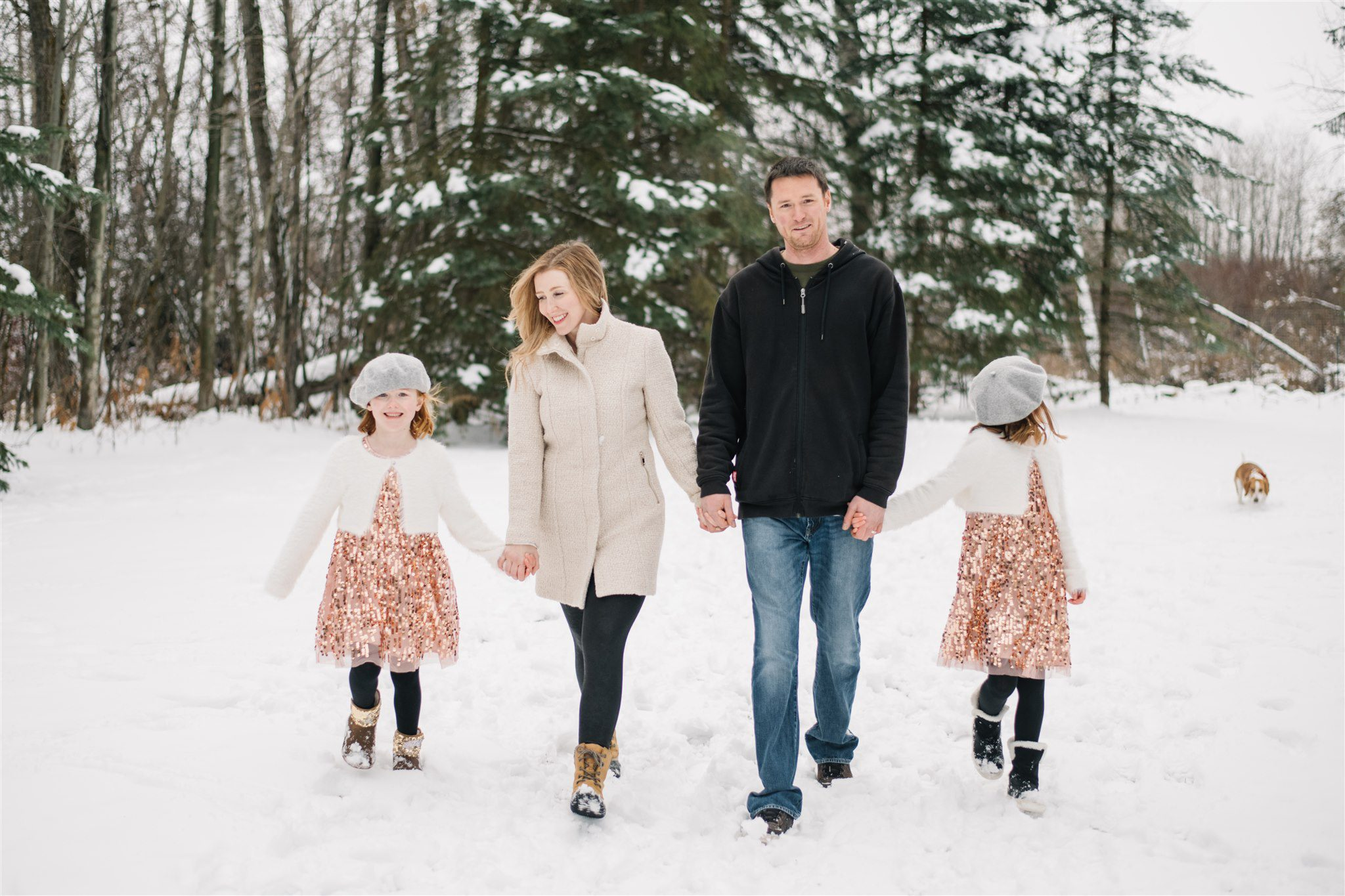Family walks in the snow