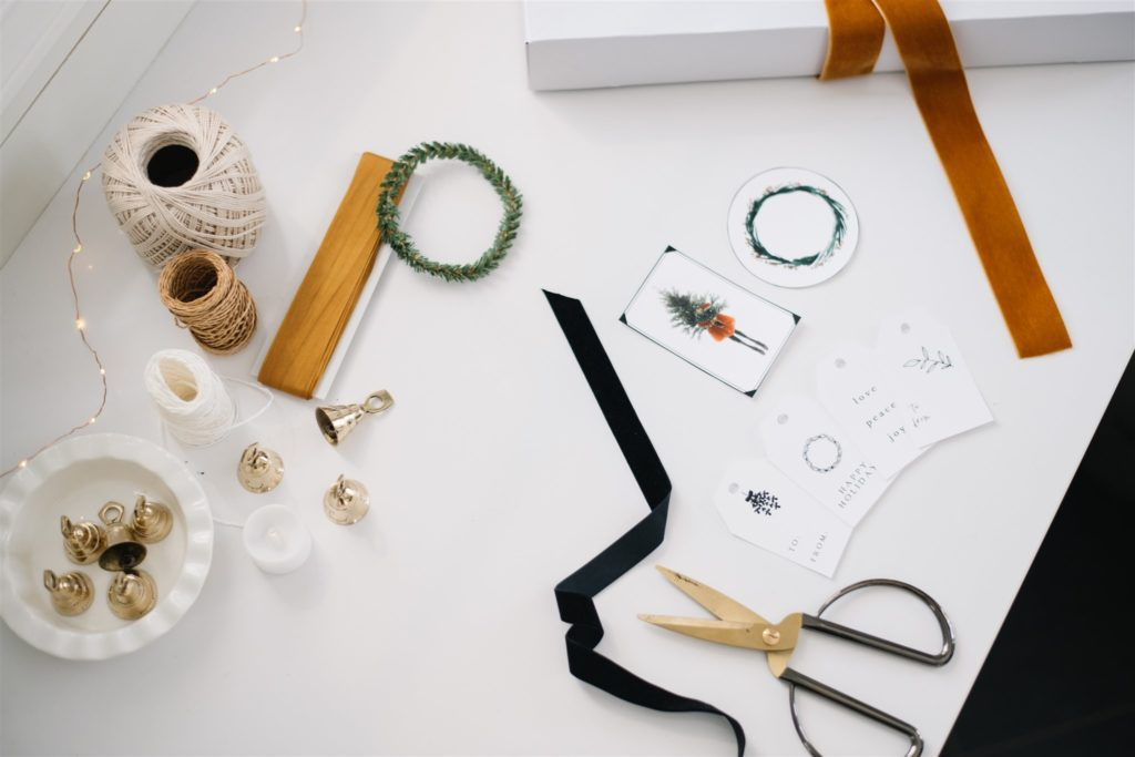 gift tags  and ribbon lying beside scissors