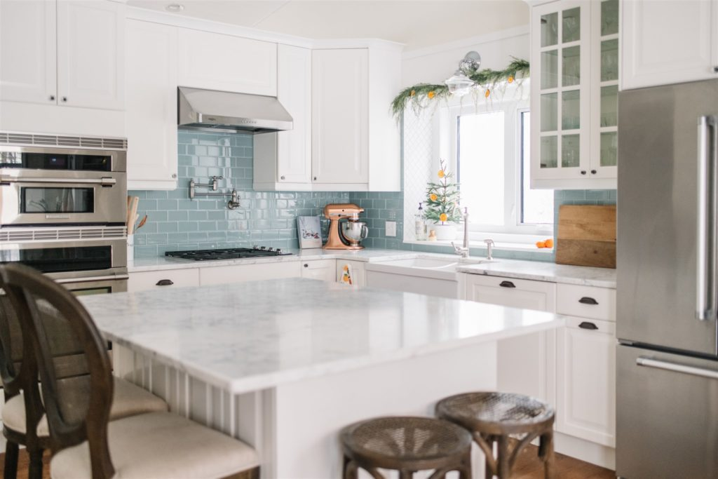 A kitchen with a large island iand farmhouse sink