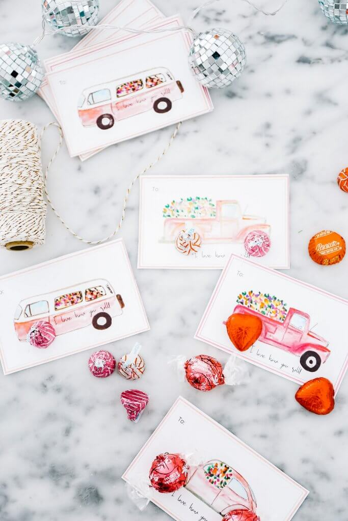 Valentine\'s day cards lying on marble counter with candies and string