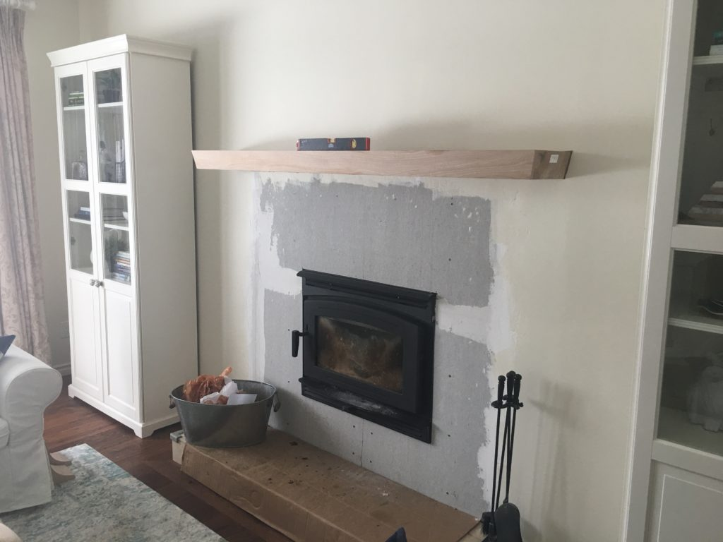 A fire place with mantle being installed above