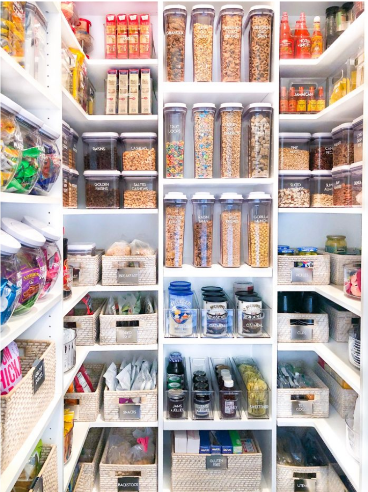 An organized pantry with food organized by colour
