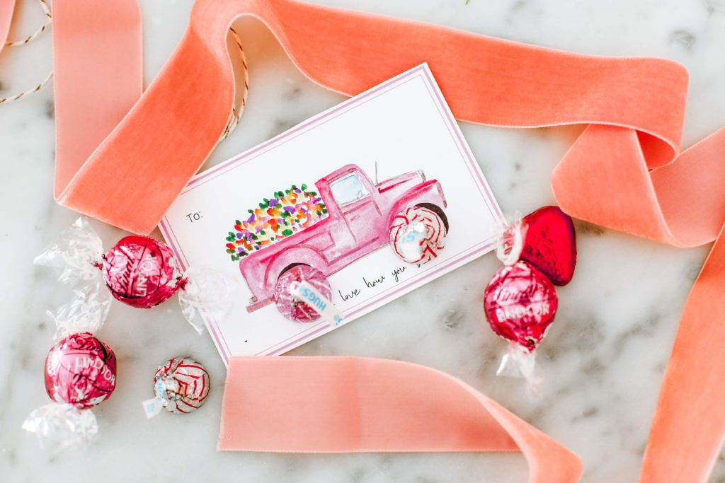 Valentine\'s day card with pink ribbon and candy on marble counter