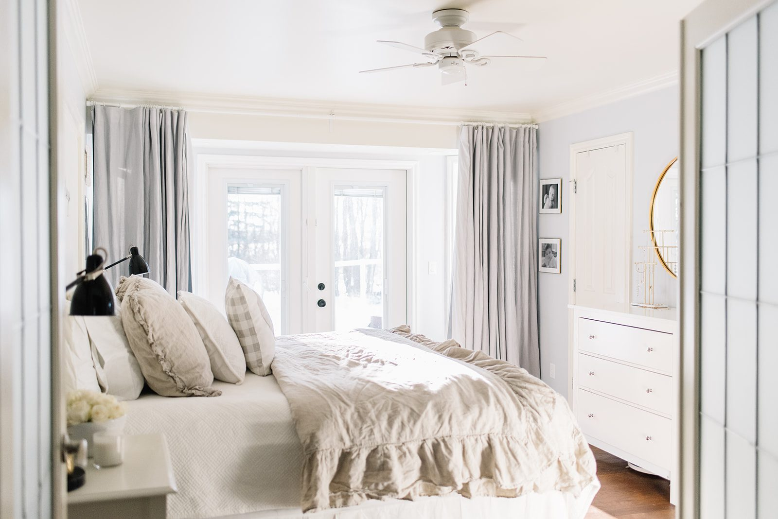 bedroom with king sized bed and ruffled duvet cover