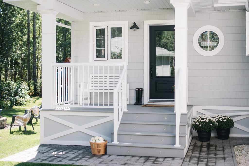 Front porch with grey decking and white railing
