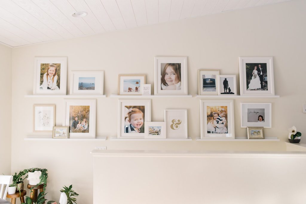 Gallery wall with white picture frames