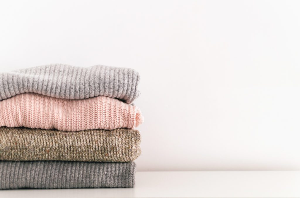 sweaters stacked and folded