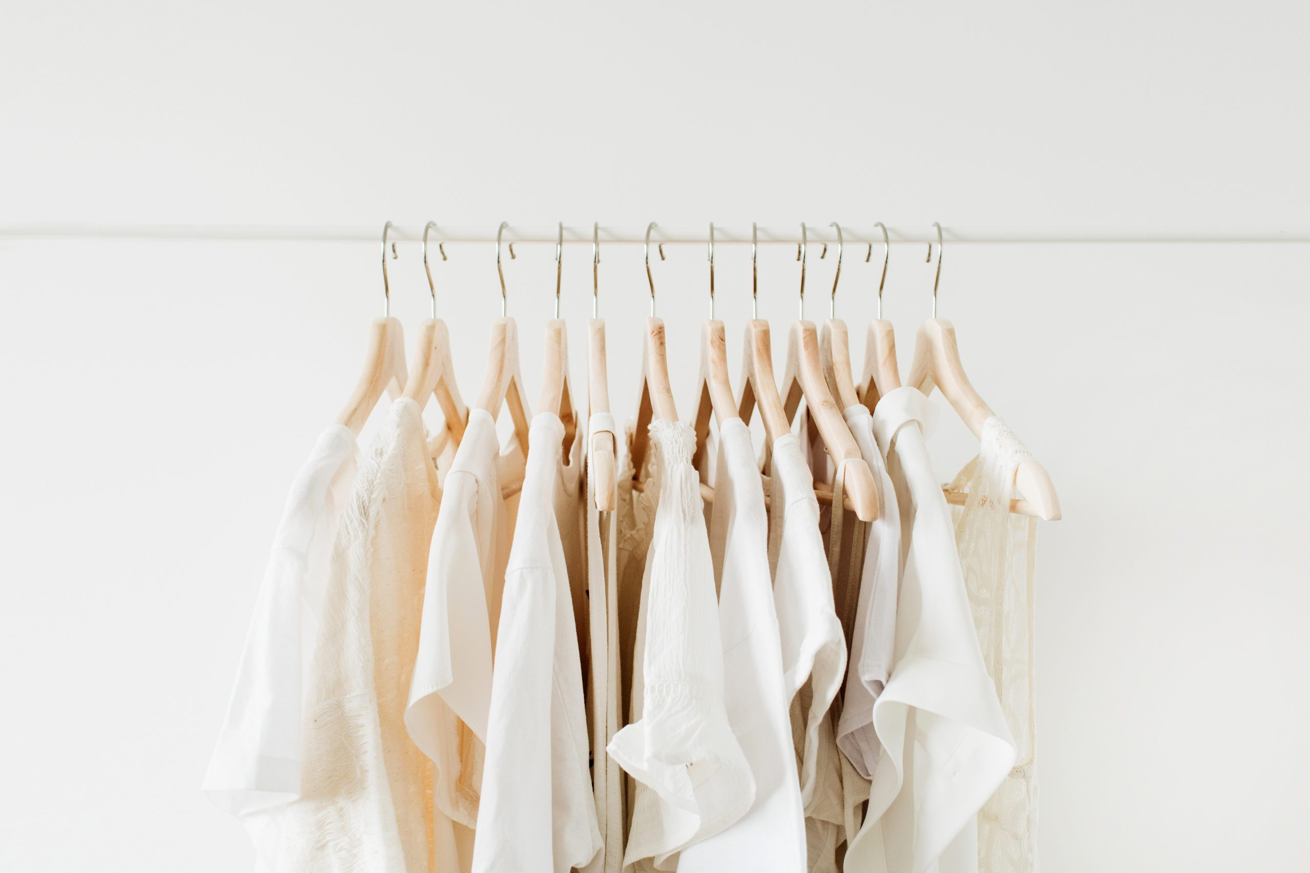 neutral clothing hanging on a rack
