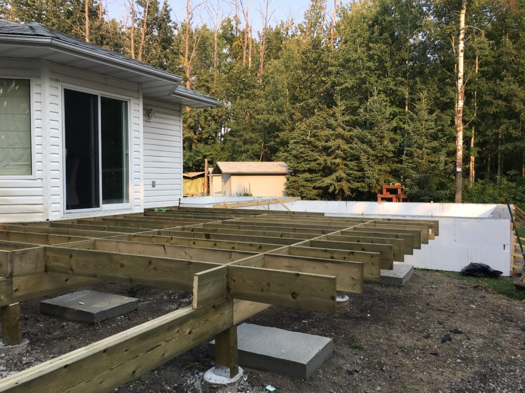 a deck being built on the back of a house