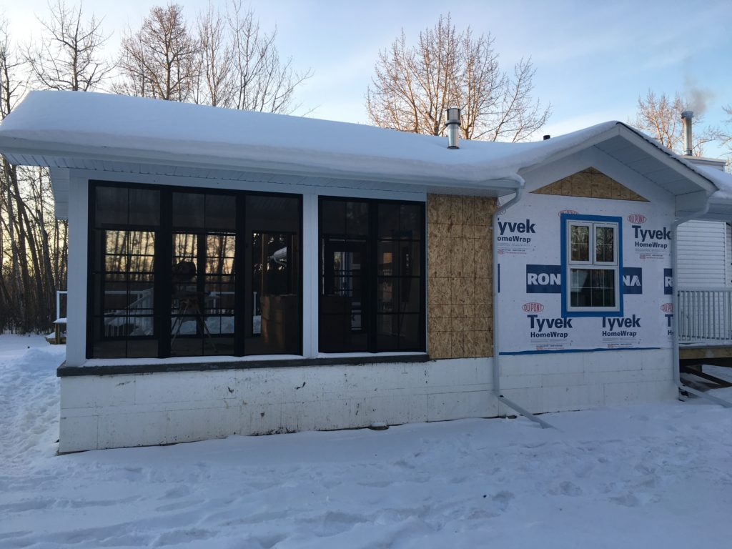 partially finished home addition covered in snow