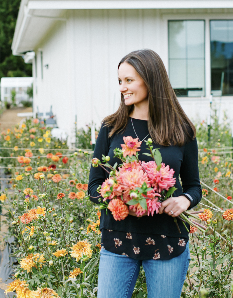 Jen from The Flowering Farmhouse holding a bouquet of fresh cut flowers