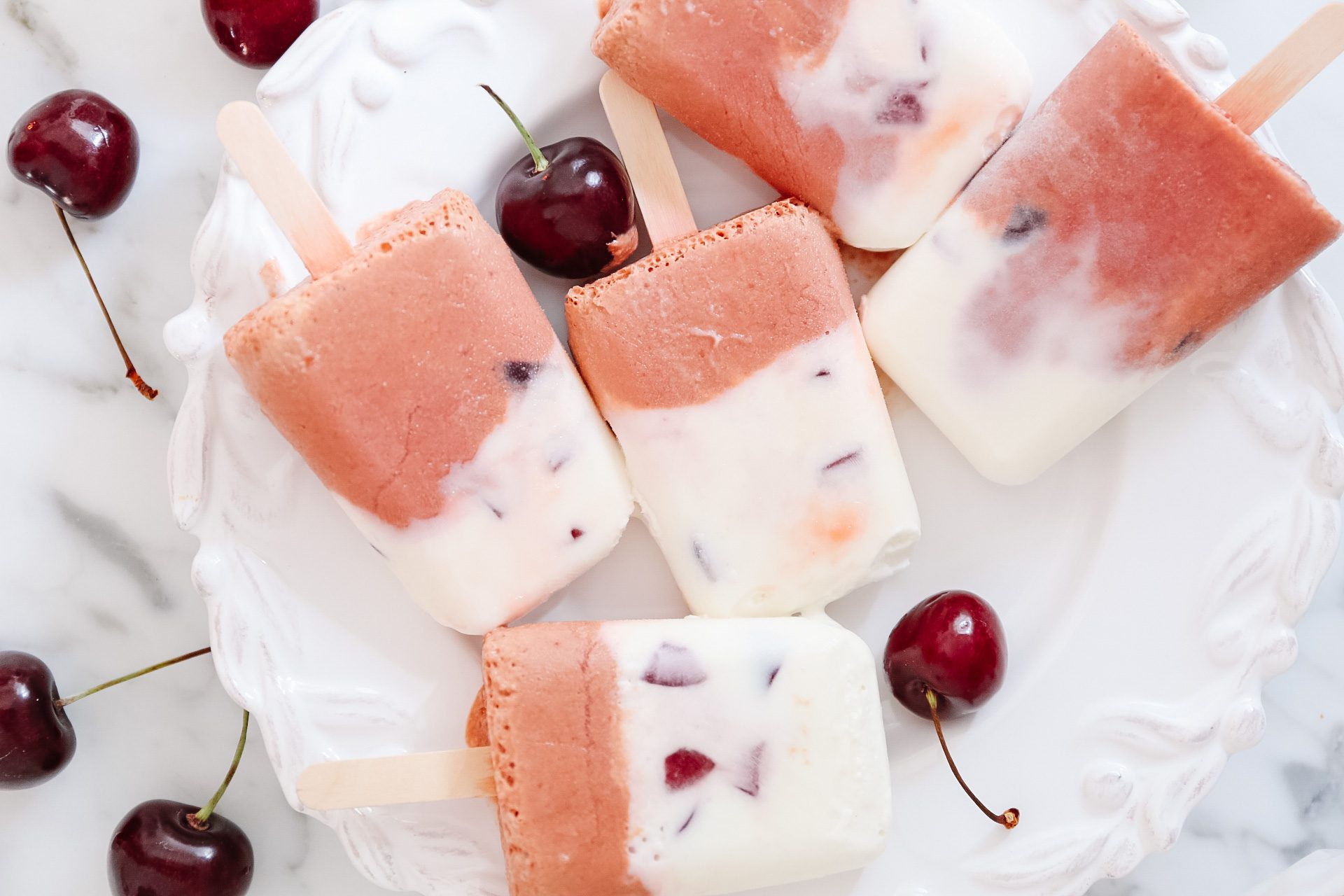 Cherry creamsicles with fresh cherries on plate