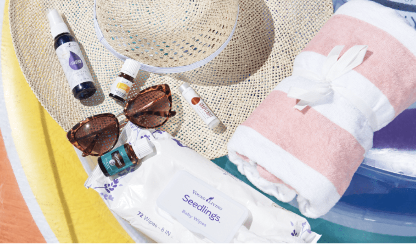Young Living essential oil products for summer sitting on top of a sun hat