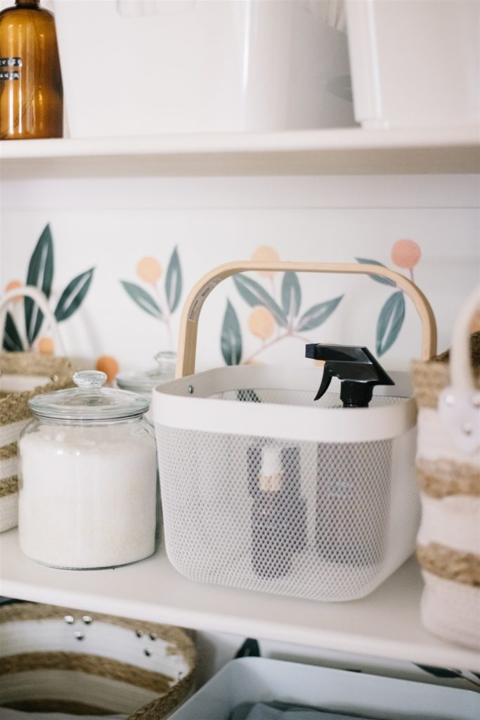 white basket with wooden handle