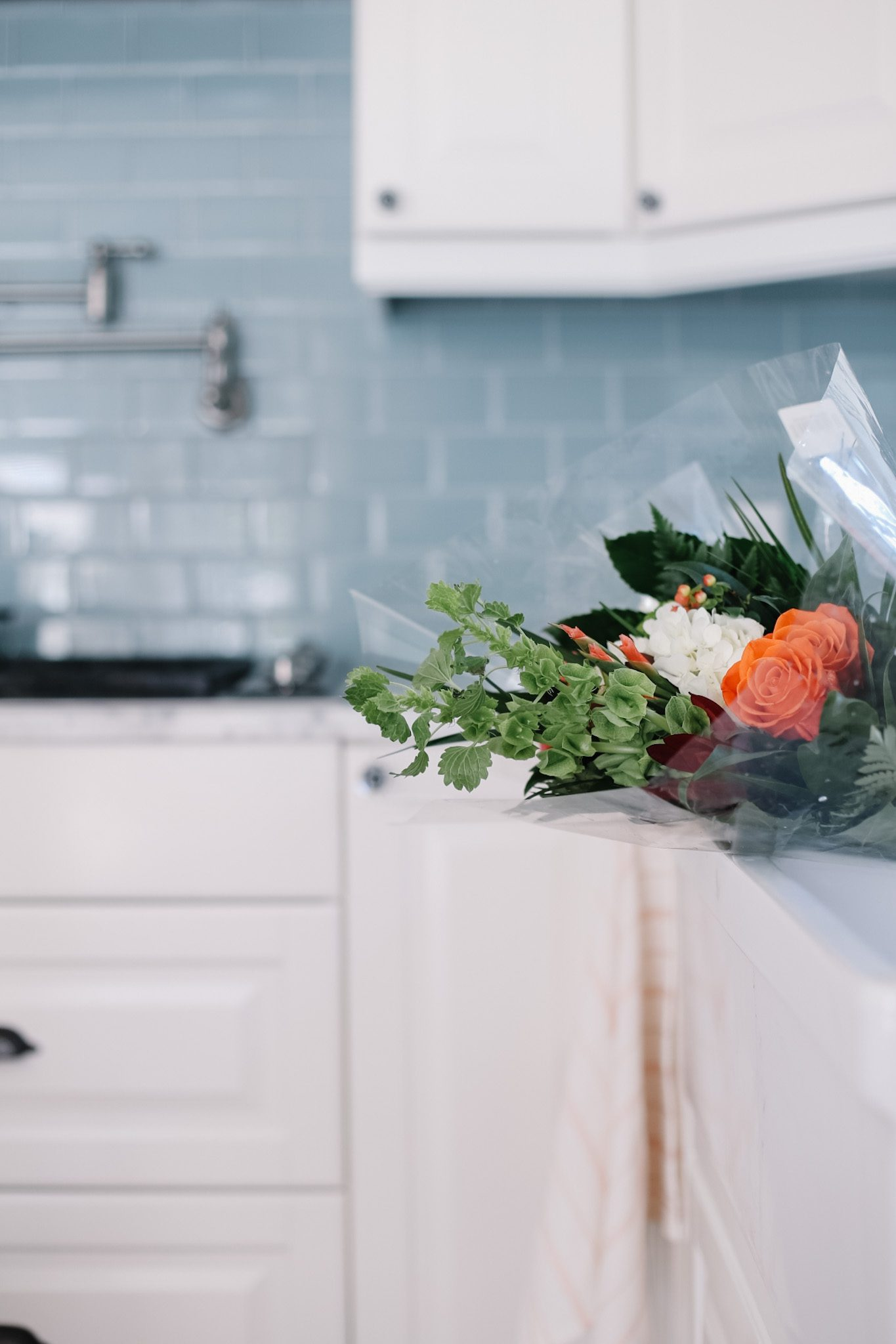 grocery store flowers sitting in the kitchen sink