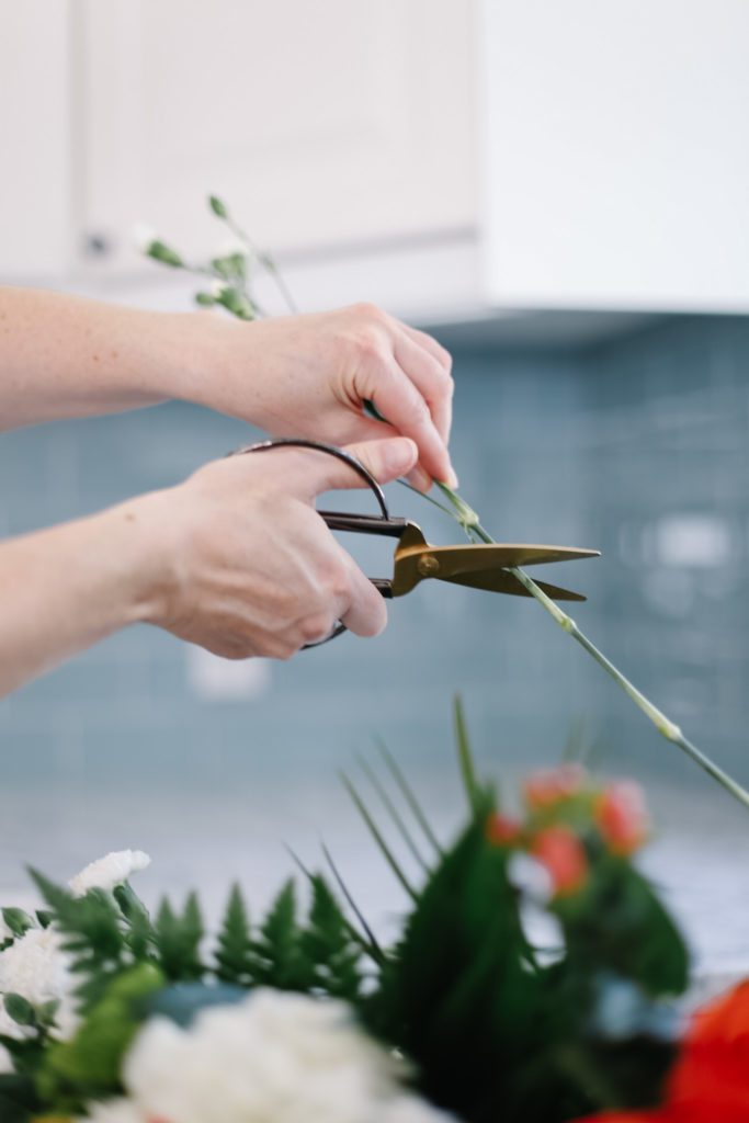 cutting flower stems with scissors