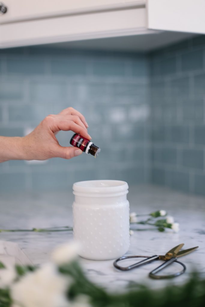 adding essential oil to flower water
