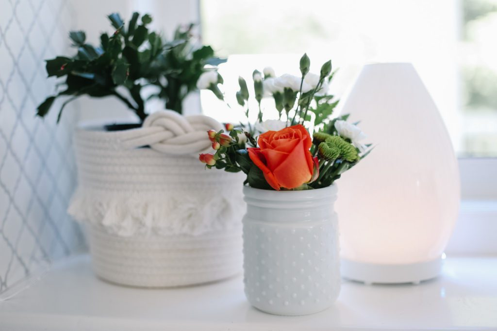 small hobnail glass vase of assorted flowers