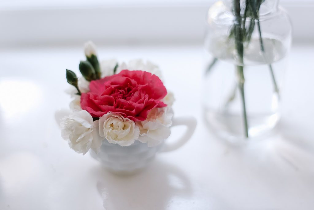 tiny sugar cup filled with flower blooms