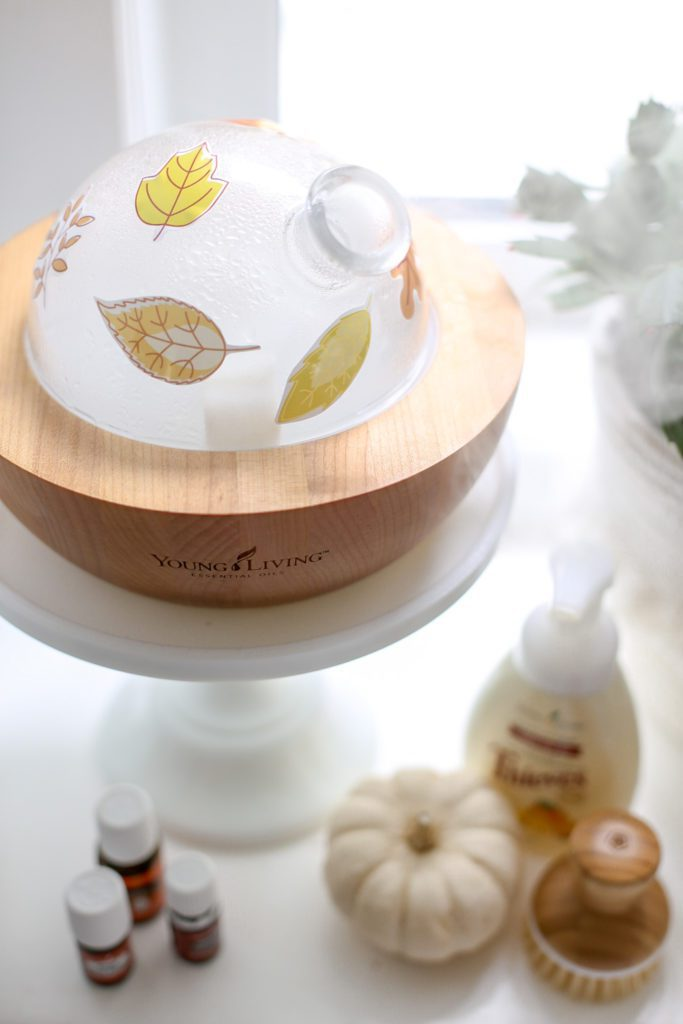 Free printable fall leaf pattern stickers on a Young Living Aria diffuser.