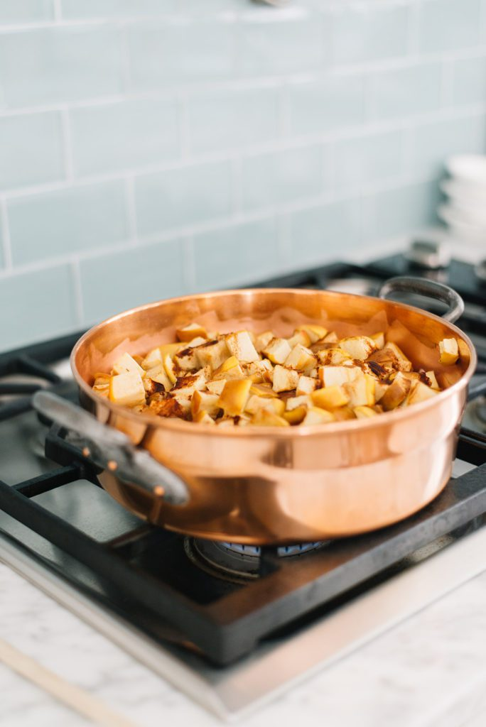 food on the stove in a copper pan
