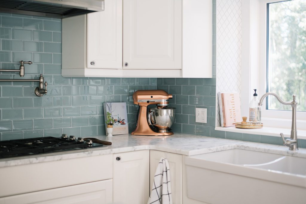 copper kitchen aid mixer sits on kitchen counter
