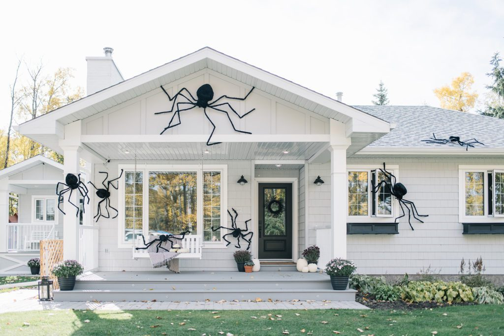 giant spiders on house for Halloween