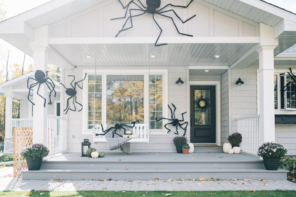 giant Halloween spiders on front porch